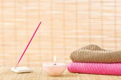 Towels and aromatic stick Stock Photos
