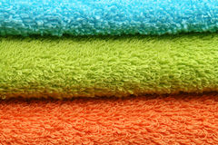 Towels background. Background of three colorful towels - orange, green and blue Stock Photo