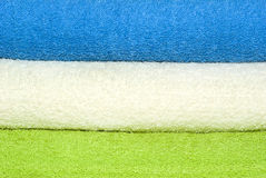 Towels background. Abstract background with 3 colorful towels stock image