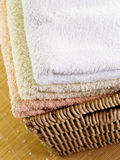 Towels in basket royalty free stock image