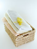 Towels in basket isolated. Towels in basket for bathroom or wellness therapy with yellow scent bag isolated Stock Image