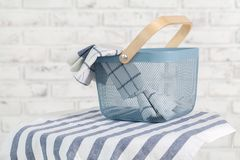Towels in basket and pins on light background Royalty Free Stock Photography
