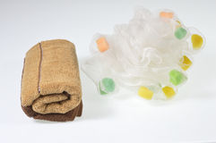 Towels and bath puff. On a white background Towels and bath puff Royalty Free Stock Photo