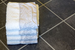 Towels in bathroom floor Royalty Free Stock Photos