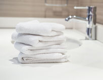 Towels in bathroom. White towels in a bathroom Stock Photos