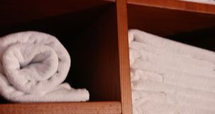Towels And Baths Are Neatly Laid In The Shelves. Close-up. Prores, Slow Motion. 4k stock footage
