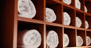 Towels And Baths Are Neatly Laid In The Shelves. Prores, Slow Motion. 4k stock video footage