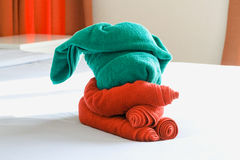 Towels on the bed Stock Images