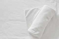Towels on bed sheet. Decorative at home stay royalty free stock photography