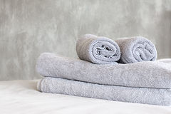 Towels on bed and stucco wall Stock Photography