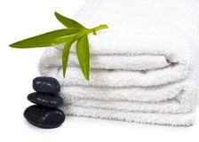 Towels, black pebbles and plants. Royalty Free Stock Photos