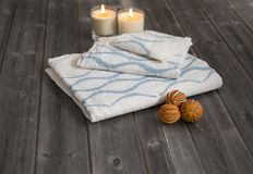 Towels with Blue Concave Lines Alongside Candles and Dried Citru Stock Photography