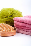Towels, body sponge and wood brush Royalty Free Stock Photo