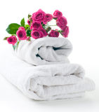 Towels and a bouquet of roses Royalty Free Stock Photography