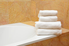 Towels on the brink of a bath Royalty Free Stock Photo