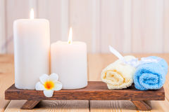 Towels and burning candles close-up still life. With frangipani Royalty Free Stock Photography