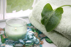 Towels candle and spa stones Stock Photos
