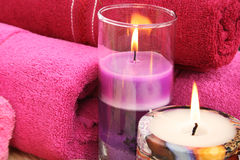 Towels and candles Stock Photos