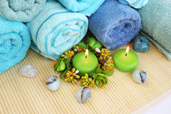 Towels, candles and stones Stock Photography