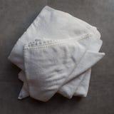 Towels on ceramic floor Stock Photos