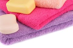 Towels. Colorful towels stack and soaps closeup picture Stock Photo