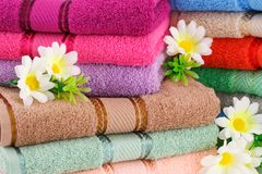 Towels. Colorful towels stacks with flowers closeup picture Royalty Free Stock Images