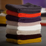 Towels. Colourful towels placed on top of one another Stock Images
