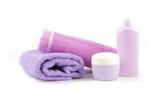 Towels and containers of creams Stock Photos