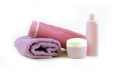 Towels and containers of creams, spa concept Royalty Free Stock Photo