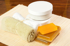 Towels, cream and handmade soap Stock Photos