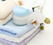Towels and creme Royalty Free Stock Photo