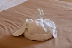 Towels decorated figures of swan in hotel room stock photos