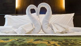 Towels decoration in bed room hotel. Stock Photo