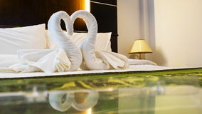 Towels decoration in bed room hotel Royalty Free Stock Images
