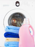 Towels with detergent and washing machine Stock Photography