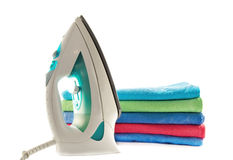 Towels and electric iron stock photos