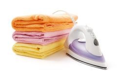 Towels and electric iron royalty free stock photo
