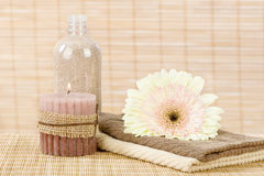 Towels, flower, candle and aromatic sand Stock Photo