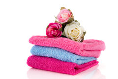 Towels and flowers Royalty Free Stock Photos