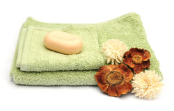 Towels and flowers Stock Images