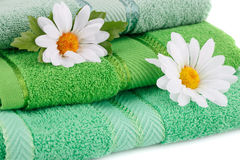 Towels and flowers Stock Photos