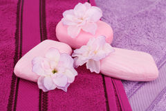 Towels, flowers and soaps Stock Images