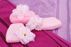Towels, flowers and soaps Royalty Free Stock Images