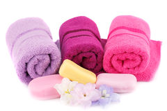 Towels, flowers and soaps Royalty Free Stock Photo