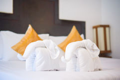 Towels in form of elephants on luxury bed in tropical beach hote Stock Photo