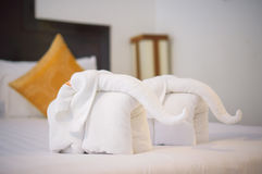 Towels in form of elephants on luxury bed in tropical beach hote Stock Image