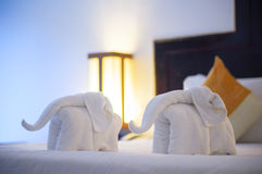 Towels in form of elephants on luxury bed in tropical beach hote Stock Images