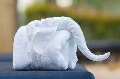 Towels in form of elephants on sunbed at luxury swimming pool Royalty Free Stock Photos