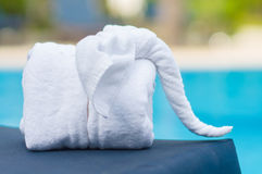 Towels in form of elephants on sunbed at luxury swimming pool Stock Photo