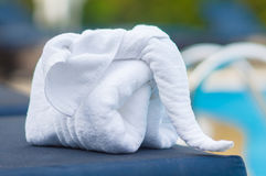 Towels in form of elephants on sunbed at luxury swimming pool Stock Photos